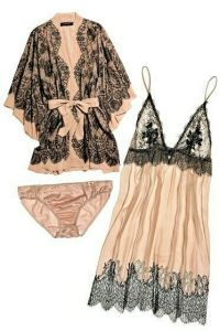 A 3 piece champagne and black lace lingerie set. There is sheer champagne colored gown with spaghetti straps with black lace trim on the top and bottom. A matching pair of champagne colored bikini underwear. A champagne colored robe with black lace lace overlay that ties in the front.