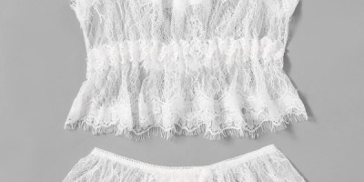 2 piece white eyelash lace lingerie set. A spaghetti strap top that is fitted at the breast area and flows to above the navel. A white thong with a lace ruffle at the top