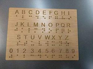 braille alphabet on rectangular wood block