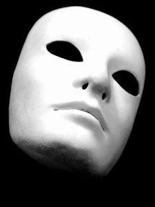 white expressionless drama mask, black background